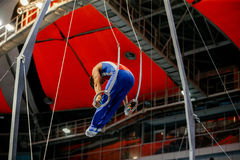 Still rings male gymnast. To competition in artistic gymnastics Royalty Free Stock Photo