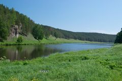 Still river with green forest on coast and clear sky. Nature beautiful blue calm lake landscape outdoor scenery scenic summer tourism travel view water stock image