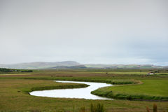 Still river among green hills in Iceland Royalty Free Stock Photo