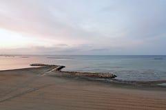 Still sea. Sunrise over the Black Sea at Mamaia resort near Constanta city in Romania stock photography