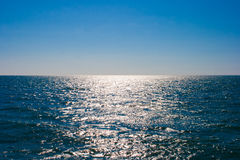 Still sea or ocean water surface and horizon stock images