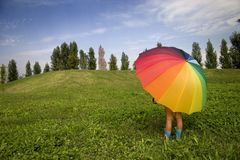 Still summer. Waiting for the first rain  under  the umbrella Royalty Free Stock Images
