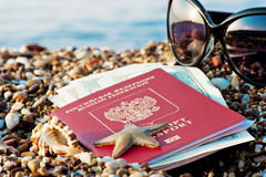 Still traveling with a Russian passport. In the sand on the beach Royalty Free Stock Image