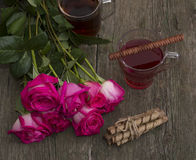 Still two cups of tea roses and cookies in conjunction Stock Photos