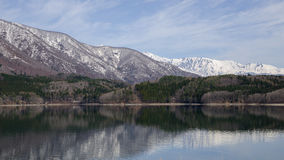Still water, Lake Aoki and Snow covered moutain,Nagano,Japan Royalty Free Stock Photo