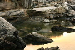 Still water in rock pool. Calm still water in coastal rock pool Stock Photos