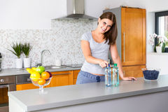 Still water vs sparkling water. In kitchen Royalty Free Stock Images