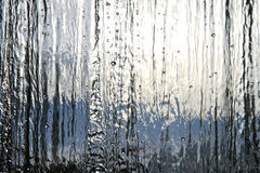 Still Waterfall. Sun and Sky in Background Stock Image