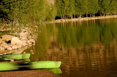 Still waters at Palisade Lake in Utah. Still waters with canoes waiting to go back on the water Stock Photo