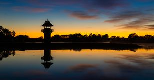 Dawn Henley Lake Tower. Still waters at Henley Lake Park, Masterton, New Zealand at dawn Royalty Free Stock Photos