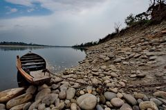 Still waters of the restless river. Eastern India. Foothills Of The Southern Himalayas. Mountain river Pangen right tributary of the Brahmaputra river royalty free stock images