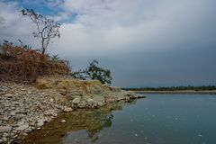 Still waters of the restless river. Eastern India. Foothills Of The Southern Himalayas. Mountain river Pangen right tributary of the Brahmaputra river royalty free stock photos