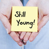 Still young. Note on hands Royalty Free Stock Image
