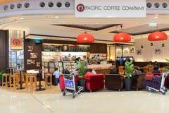 Stillahavs- kaffekafé i flygplats Arkivfoton