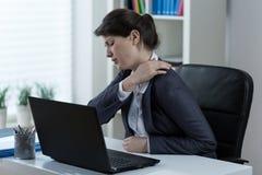 Stillasittande orsaka för livsstil som är tillbaka, smärtar arkivbild