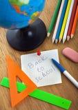 Stillbild-liv med skolar tillbehör arkivbild