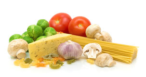 Stilleben av ny mat på en vit bakgrund Arkivfoto