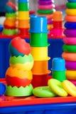 Stilleben från mång--färgade leksaker arkivbilder