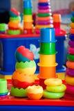 Stilleben från mång--färgade leksaker royaltyfria foton