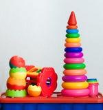 Stilleben från mång--färgade leksaker royaltyfria bilder