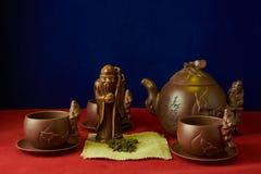 Stilleben med en statyett av guden av te Royaltyfri Fotografi