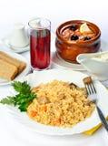 Stilleben med soppa och ris. Arkivfoton