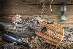 Stilleben med ukulelet på ladugårdstudiobakgrund Royaltyfria Bilder