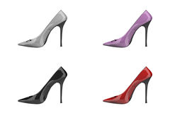 Stilleto Heeled Shoes. Four stilleto heeled shoes in black, red, pink and white against a white background Royalty Free Stock Images