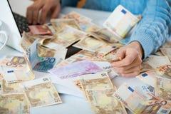 Stilleven met heel wat contant geld en notitieboekje Stock Foto
