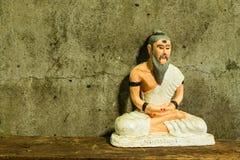 Stilleven met kluizenaarstandbeeld, Medische Leraar van India Stock Fotografie