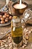 Stilleven van argan olie met vruchten stock foto
