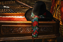 Stillife with cimbalom and hat Stock Photos