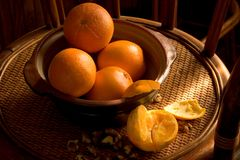 Stillife with sunray. Natural light image of stillife with oranges and walnuts Royalty Free Stock Images