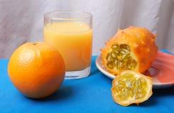 Stillleben mit orange Früchten Stockfotografie