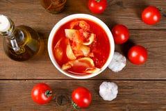 Stillleben mit Tomaten und Zwiebel Stockfotografie