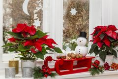 Still life at christmas with snowman and sled stock photo