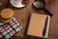Stilllife with a notebook on the wooden table Stock Images