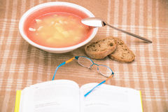 Stilllife with soup plate and book Stock Photo