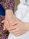 Stillness. The doctor holding an elderly woman's hand Stock Photos