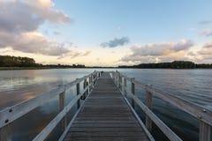 Stillsam sjö på solnedgången Royaltyfri Fotografi