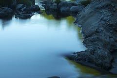 Stillwater pool with dark rocks, Farmington River, Nepaug Forest Stock Photos