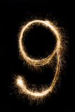 Stilsortstomtebloss nummer nio för nytt år på svart bakgrund Arkivbild