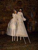 Stilt artits walk during a performance stock photos