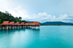 Stilt bungalows of luxury tropical resort. Luxury tropical resort scene from Langkawi island, Malaysia royalty free stock images