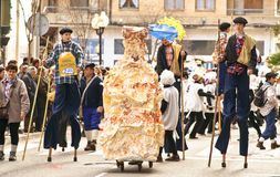 Stilt dancers parade through the streets during th Stock Image