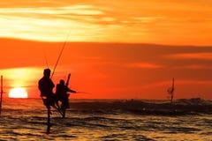Stilt fisherman. Sunset at sri lanka royalty free stock photography
