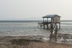 Stilt fishermen at sea. Kampot, Cambodia Royalty Free Stock Photo