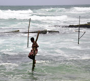 Stilt fishermen in Sri Lanka Royalty Free Stock Photography