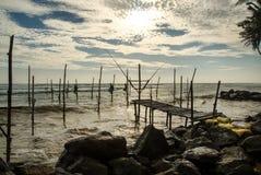 Stilt fishermen in Sri Lanka Stock Photo