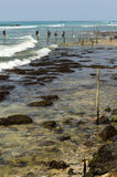 Stilt fishermen in Sri Lanka Stock Photos